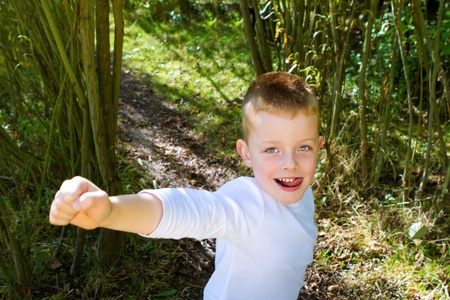 little boy smiling in the woods Stock Photo - 15945790