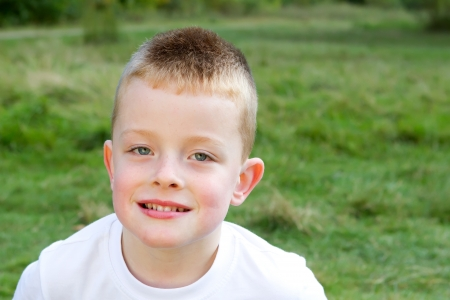little boy smiling in the evening Autumn sun Stock Photo - 15945803