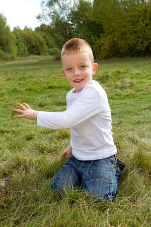 little boy playing in the countryside Stock Photo - 15945851