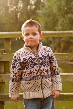 wolly: little boy smiling in the evening Autumn sun