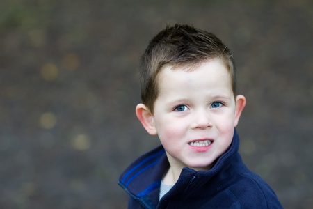 little boy smiling in the woods Stock Photo - 15945795
