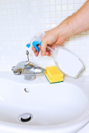 anti bacterial soap: Cleaning bathroom sink with spray bottle Stock Photo