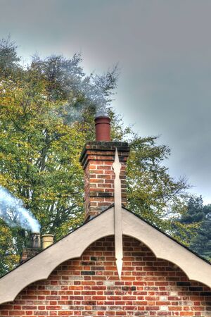 chimney smoke coming from an old fashioned house photo