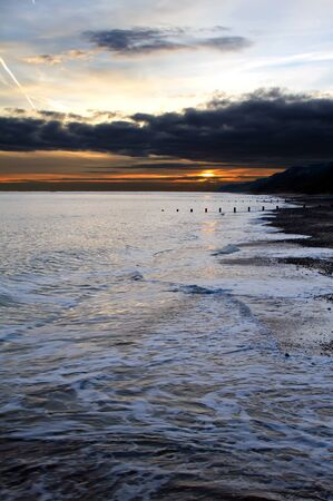 edwardian: Sunset at the beach at Cromer Norfolk, East Anglia Stock Photo