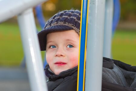 little boy playing on apparatus at the park Stock Photo - 16799146