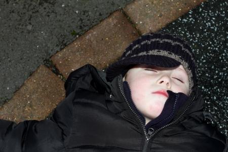 litte boy knocked down  outside oon tarmac
