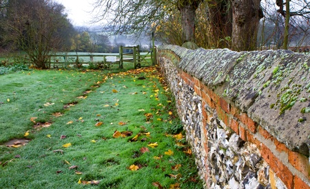cobbled wall leading down to fields photo