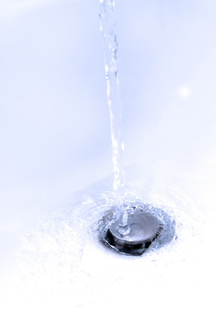 water running down a bathroom sink plug hole Stock Photo - 16803334