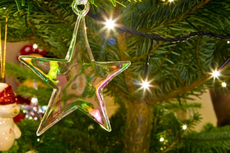 christmas star hanging on the christmas tree Stock Photo - 16803349