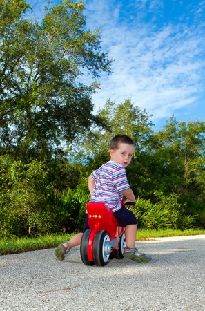 boy riding on a toy motorbike Stock Photo - 17277149