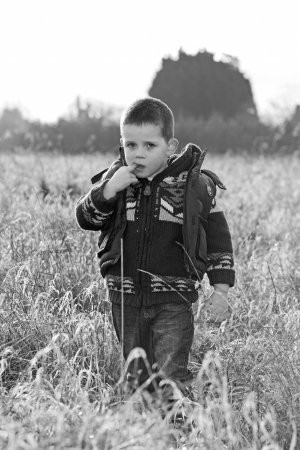 sad little boy in the countryside Stock Photo - 17277098