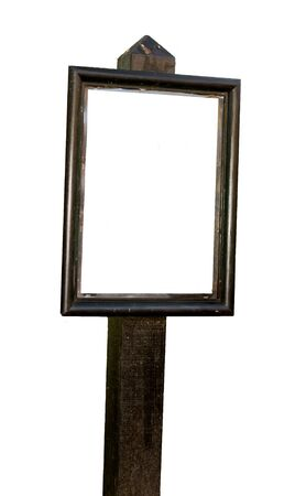 wooden post: blank white sign in a wooden frame with post in countryside