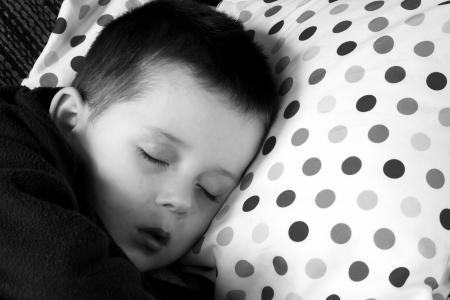 unwell sick child laying on pillow Stock Photo