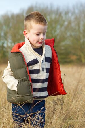 boy in a country field in the winter Stock Photo - 17277089