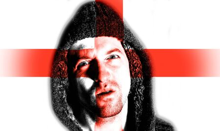 Hooded angry man with bEnglish flag design on face photo