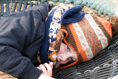 sad little boy pulling sad expression photo