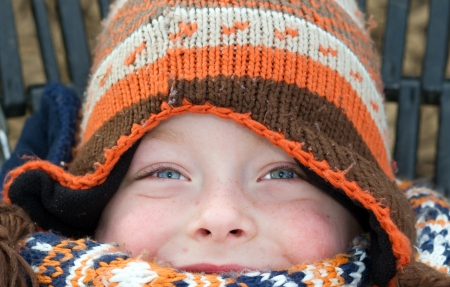 happy eyes of a boy on a cold winters day photo