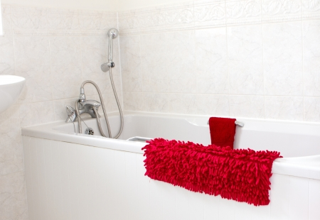 white bathroom with red towels Stock Photo - 18924688