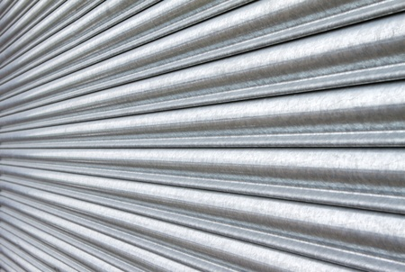 security shutters: silver metal roller security shutters closed down