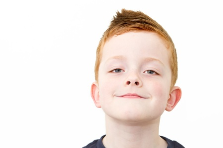 smiling happy little boy with ginger hair Stock Photo