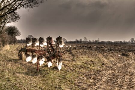 agricultural plough machine in a field in the spring photo