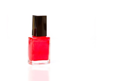 red nail varnish with reflection and copy space photo