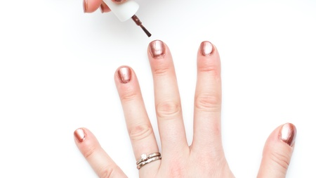 ordinary woman with non perfect hands painting nails photo