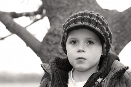 lonely boy: sad little boy staring ahead