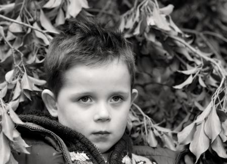 sad little boy staring ahead photo