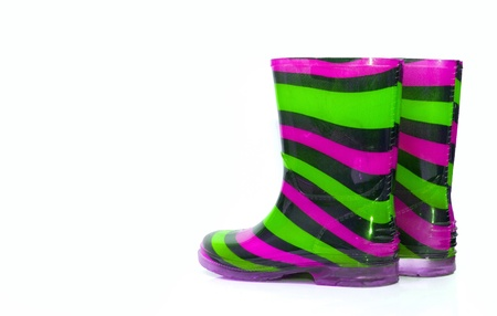 Multi Coloured wellington Boots on white with copy space photo