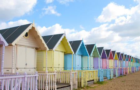 Traditional British beach huts on a bright sunny day
