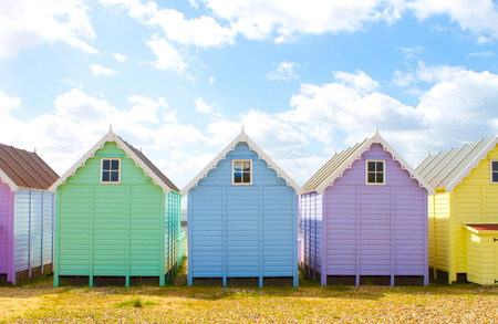 Traditional British beach huts on a bright sunny day photo
