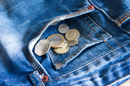 UK coins falling out of jeans pocket photo