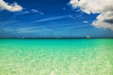 Shallow bay and crystal clear waters of Barbados, Bridgetown, Brownes Beach. Imagens