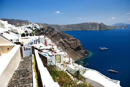 Beautiful blue waters and white Cycladic architecture of Fira, Santorini