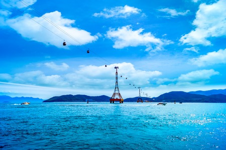 trang: The cable car at Nha Trang beach on the blue sky background Stock Photo