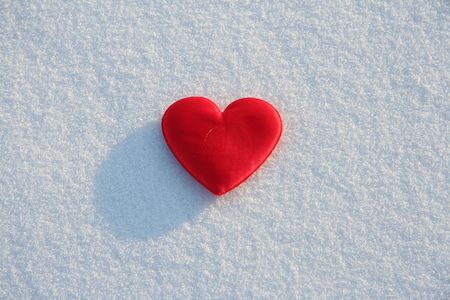Red silk heart on the snow photo