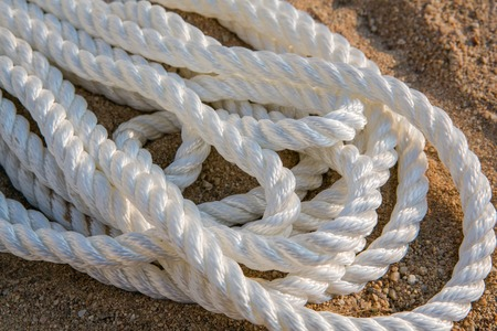 cable knit: Big white marine sea ropes in heap - the background