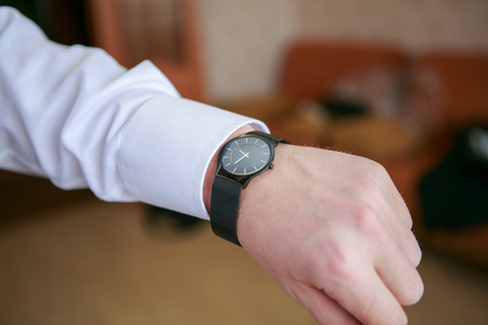 mans watch: Black mans watch on the wrist Stock Photo