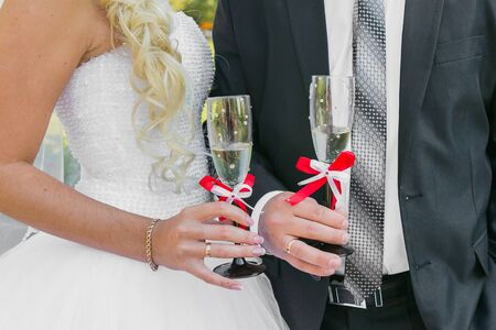 Wedding couple. The bride and groom with champagne glasses. photo