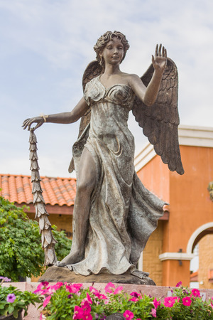 pons: Statue of an angel in Sivedr Lake, south Pattaya, Thailand.