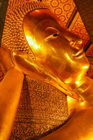reclining: Reclining Buddha at Wat Pho, Bangkok, Thailand. Stock Photo