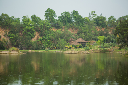 hotel resort: Lake with small bungalow made of bamboo. Stock Photo
