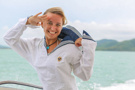 Young Beautiful Adorable Woman in Russian sailor uniform in sea.