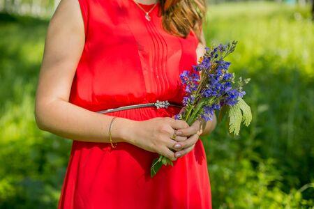 bluet: Little blue flower bouquet in female hand Stock Photo