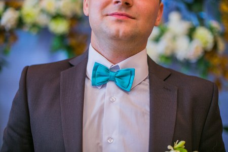 dinner jacket: Blue and white grooms bow tie close up