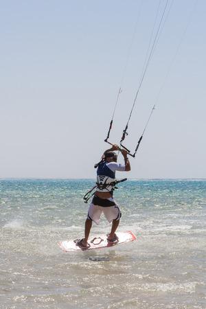 kiter: Sharm-El-Sheykh, Egypt - June 06, 2010 :: A kite surfer rides the waves.