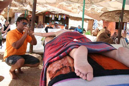 restore energy flow: Sharm-El-Sheykh, Egypt - May 29, 2010 :: Woman having a back massage on the beach