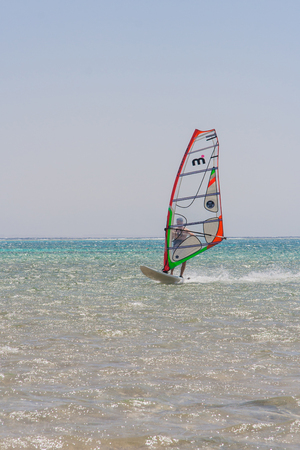 afloat: Sharm-El-Sheykh, Egypt - May 25, 2010 :: Windsurfer rides in a red sea of Egypt. Editorial