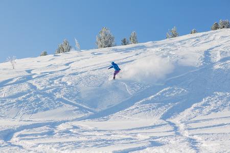 off piste: Snowboarder riding fresh snow powder in mountains. Stock Photo